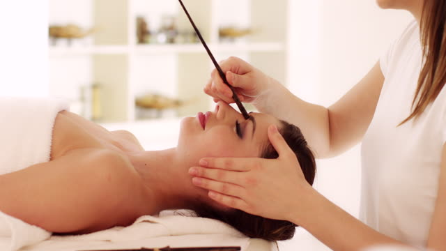 Young woman enjoying head massage Young woman enjoying massage at the spa. Video. spa treatment stock videos & royalty-free footage