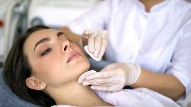 Young woman enjoying of facial massage in beauty salon Young woman enjoying of facial massage in beauty salon. dermatology stock videos & royalty-free footage