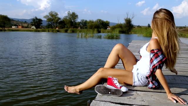 young woman enjoying the sun video