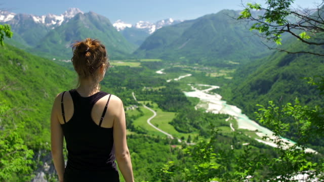 Young woman enjoying the view at a mountain valley video