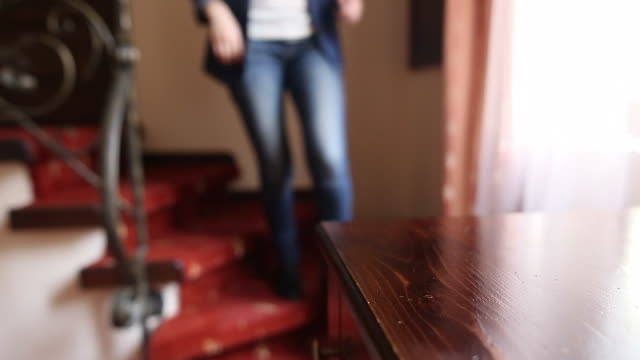 Young woman entering in the house.