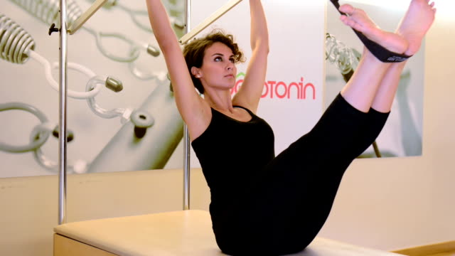 Young woman exercising in the pilates studio video