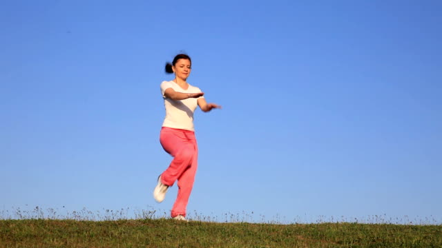young woman exercising. video