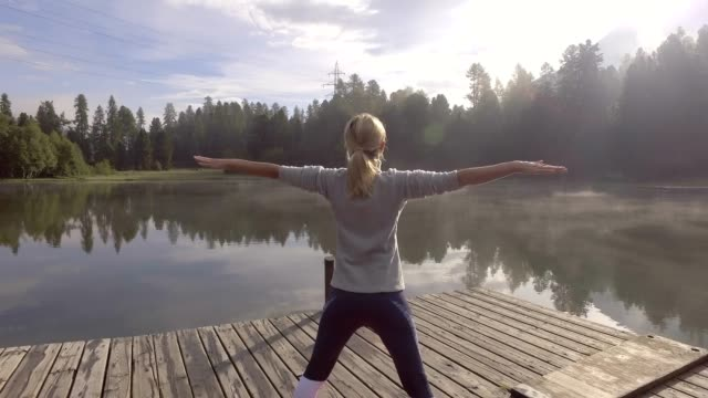 4K, Young woman exercising yoga in nature, Switzerland video