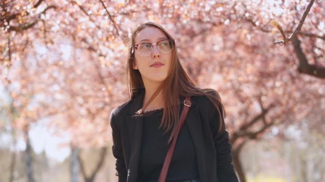 young woman exploring spring - gente serena video stock e b–roll