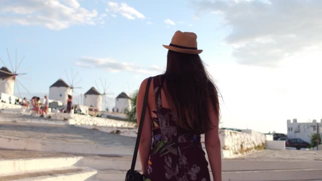 Young Woman Exploring The Streets Of Mykonos, Greece Young Woman Exploring The Streets Of Mykonos, Greece greek islands stock videos & royalty-free footage
