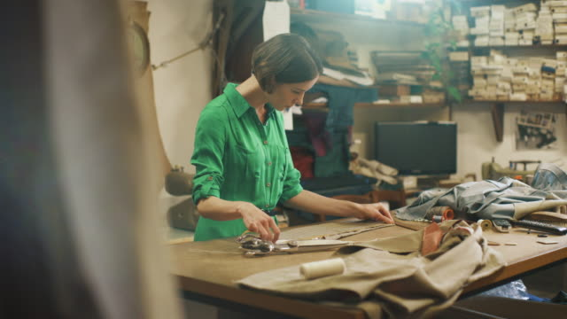 Young Woman Fashion Designer Works in Studio. Using Measuring Tape. video