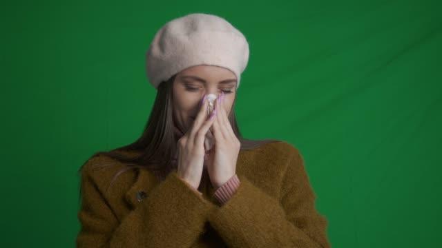 Young woman feeling sick. Green screen video