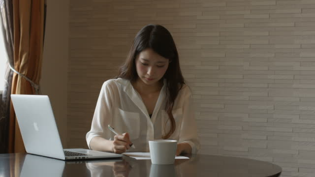 Young woman filling out a document Young woman filling out a document and signing it form filling stock videos & royalty-free footage