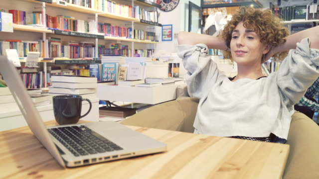 Young woman finishing a succesful work. video