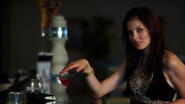 Young Woman Flirts with Camera at Bar
