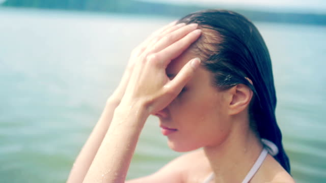 Young woman floating on back in lake video