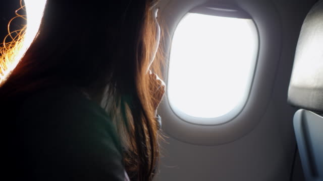 young woman flying in an airplane video