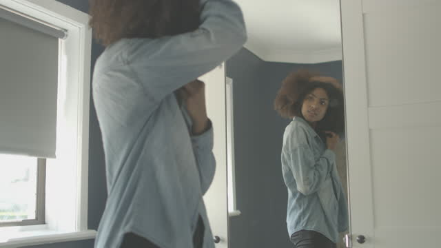 Young Woman Getting Dressed at Home video