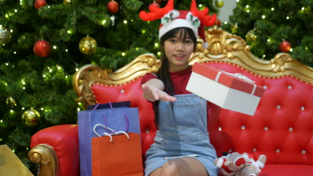 young woman giving Christmas present , facial expression video