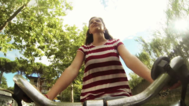 Young Woman Going by Bike video