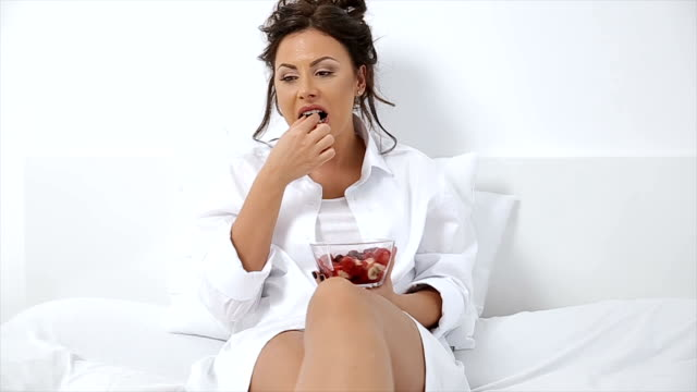 Young woman having a fruit salad Young woman having a fruit salad charming stock videos & royalty-free footage