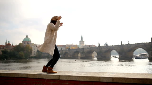young woman having fun in prague,by charles bridge - shoes fashion stock videos and b-roll footage