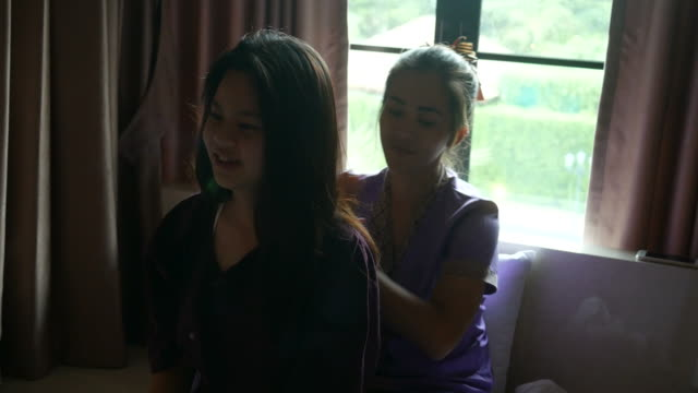young woman having relaxing  with Thai massage video
