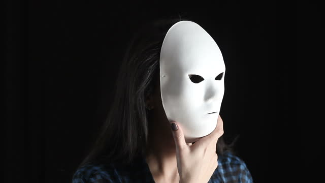 Young Woman Hiding True Color Behind Mask video
