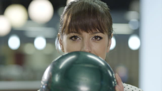 Young woman holding bowling ball video