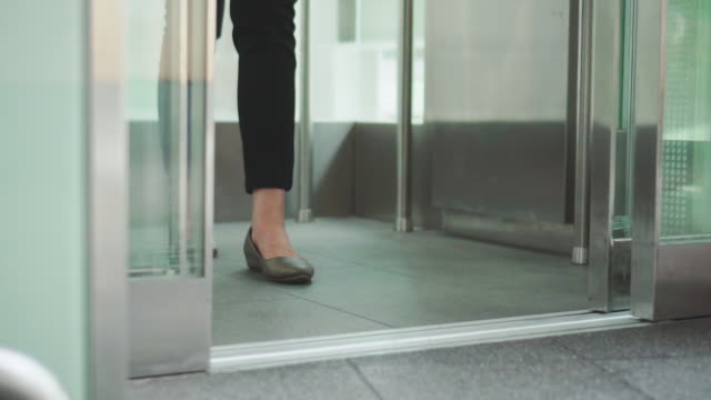 young woman holding shopping bags and using elevator,tilt up - ascensore video stock e b–roll
