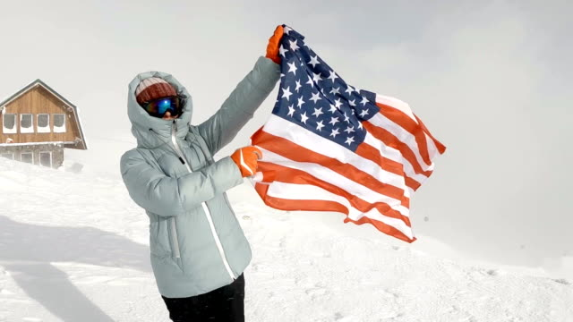 young woman holding usa flag at winter - independence day stock videos & royalty-free footage