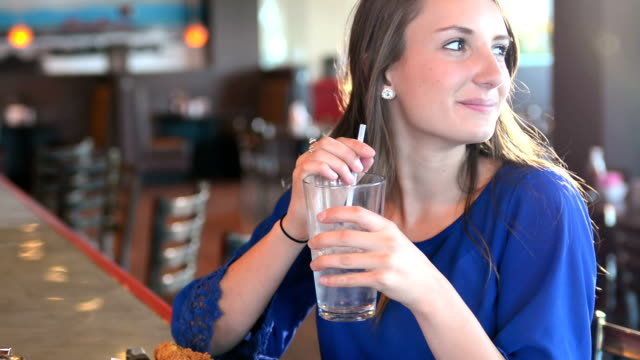 Young woman in a cafe video