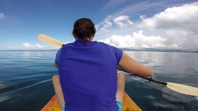 Young woman in a kayak, kayaking video