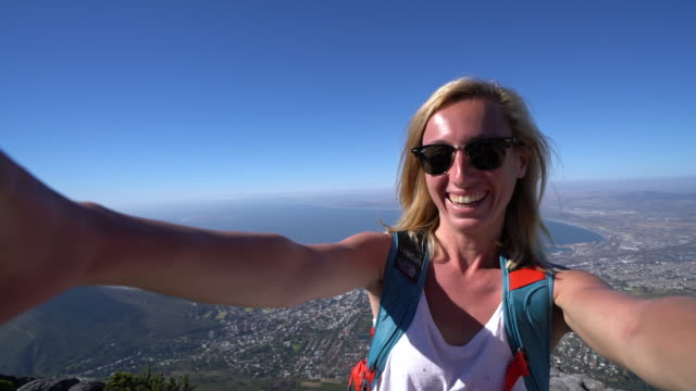 Young woman in Cape Town taking selfie portrait Young woman in Cape Town takes selfie portrait from Table Mountain top table mountain national park stock videos & royalty-free footage