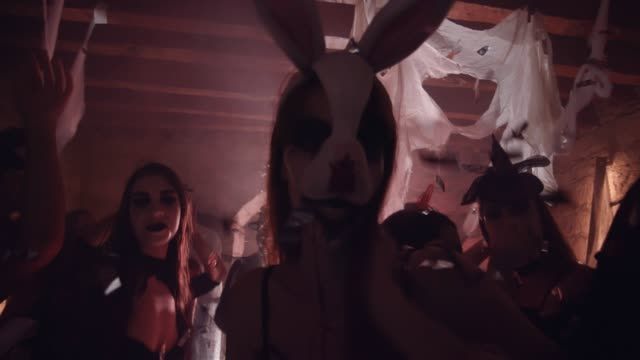 Young woman in evil bunny costume dancing at Halloween party Woman in evil bunny costume and scary bloody make-up dancing at dungeon Halloween party sensualitet stock videos & royalty-free footage