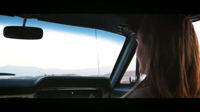 Young woman in front passenger seat of car on the highway Young woman in front passenger seat of car on the highway rear view mirror stock videos & royalty-free footage