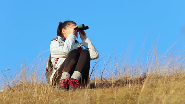 Young woman in nature exploring. video