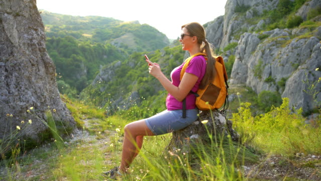 Young woman in nature using smart phone