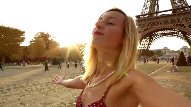 Young woman in Paris arms outstretched video