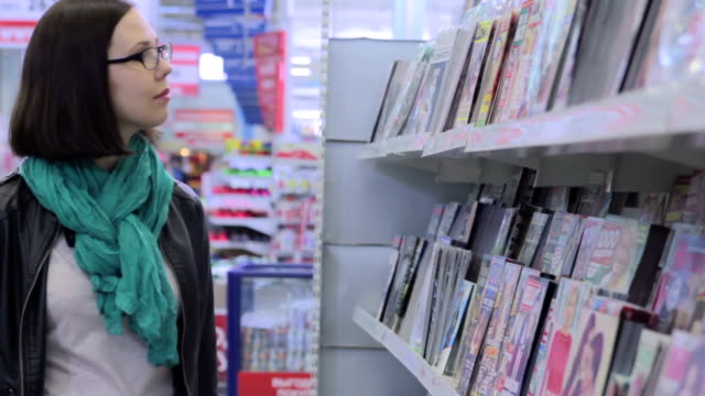 Young woman in supermarket video