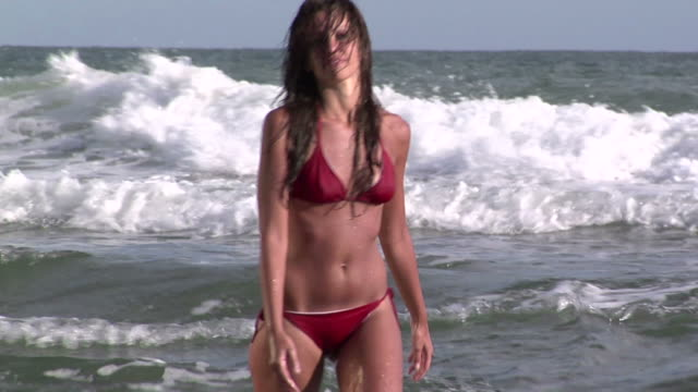 Young woman in the beach Young woman runs in to the sea  leotard stock videos & royalty-free footage
