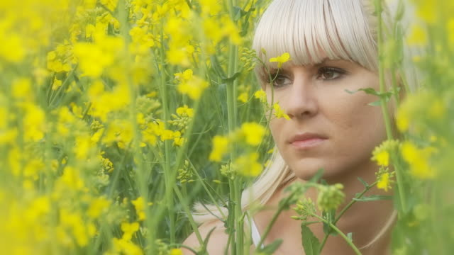 HD DOLLY: Young Woman In The Canola Field video
