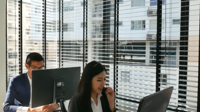 young woman in the office with headset video