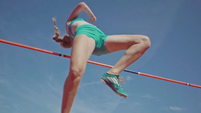 young woman in training for track and field young woman in high jump track and field athleticism stock videos & royalty-free footage