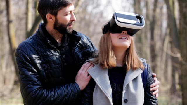 Young Woman In Virtual Glasses Looks Around video