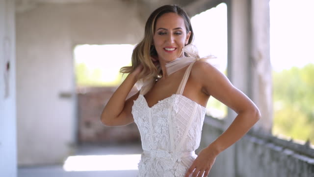 Young woman in white elegant and luxury long dress video
