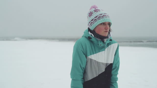 Young woman in winter clothes trying to warm up Young woman in winter clothes trying to warm up Odessa shivering stock videos & royalty-free footage