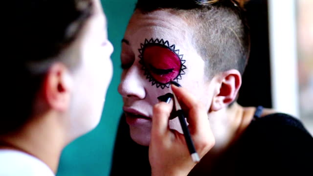 Young Woman Is Getting Sugar Skull Mask Drawn video