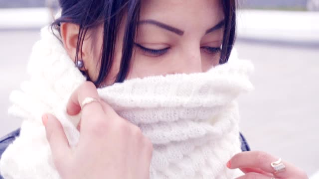 Young woman is hiding using her scarf video