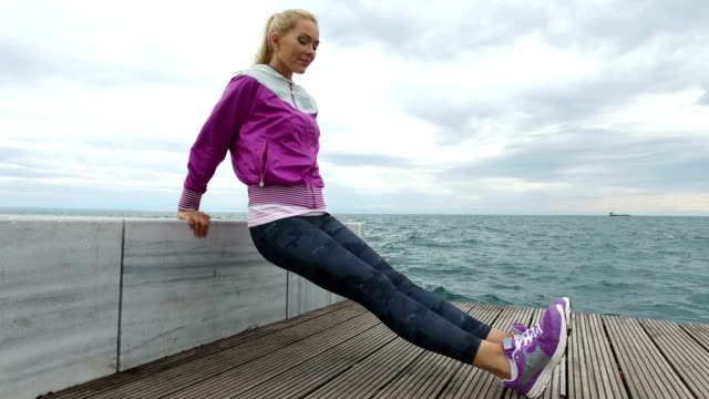 Young woman Jogging next to the sea video