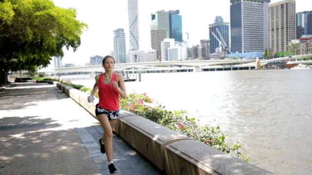 Young Woman Jogging on Brisbane Southbank video
