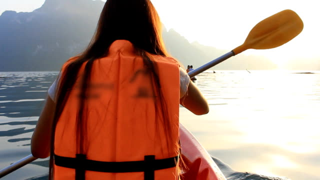 Young woman kayaking video