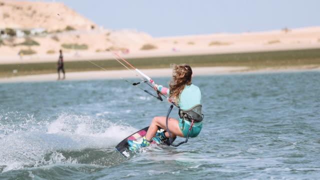 Young Woman Kitesurfing in Dakhla, Morocco