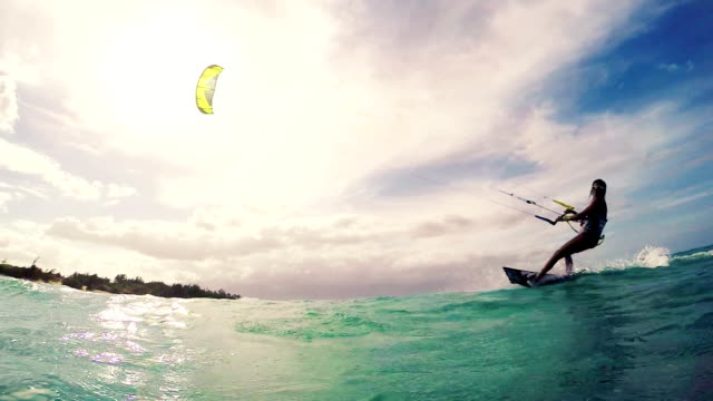 Young Woman Kitesurfing in Ocean. Summer Fun Extreme Sports. video